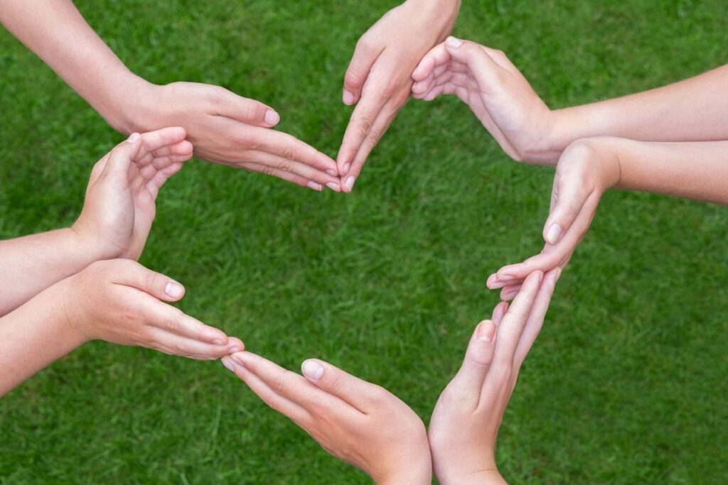 Hands together forming a heart